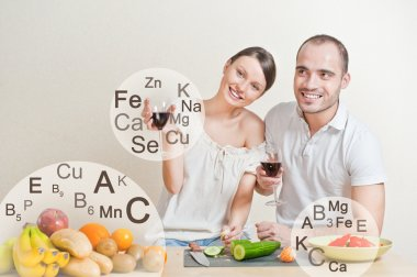 Young lovely couple cooking a balanced diet. Big copyspace. Vita