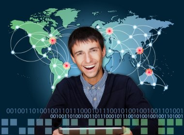 A business man is using the internet. A map of the Earth with gl
