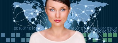 A business woman is using the internet. A map of the Earth with
