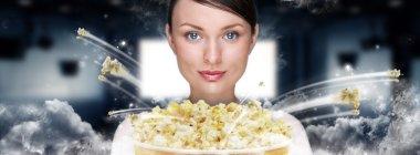 Portrait of young stylish modern woman watching movie at modern