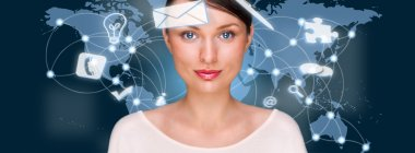 A business woman with icons of her affairs floating around her head. Portrait of pretty girl working with her virtual pc looking at camera and smiling. Daily deals online. World map at the back