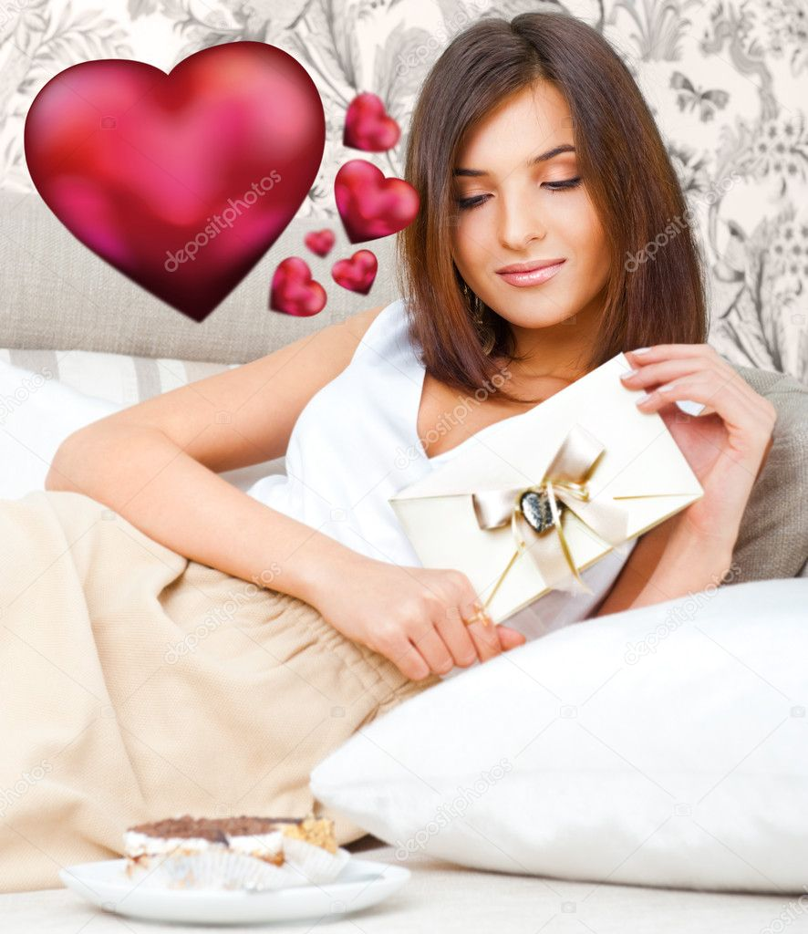 Portrait Of Young Pretty Woman Lying On Soft Comfortable Sofa And