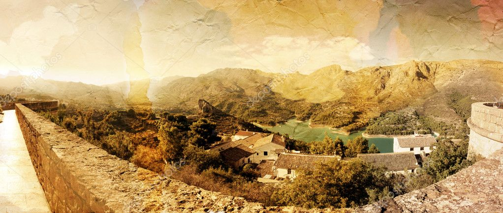 Panoramic view of beautiful mountains and lofty lake. Guadalest, Spain. Old photo style