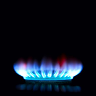 Blue and red gas stove in the dark