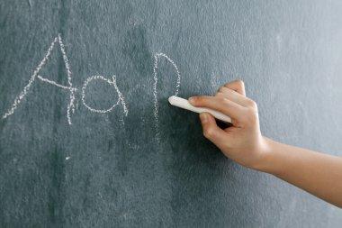 Little girl writting abc