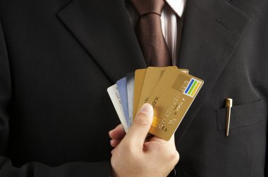 Man shown credit cards