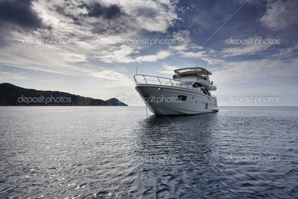 Italy, Elba Island, view of the coastline and a luxury yacht