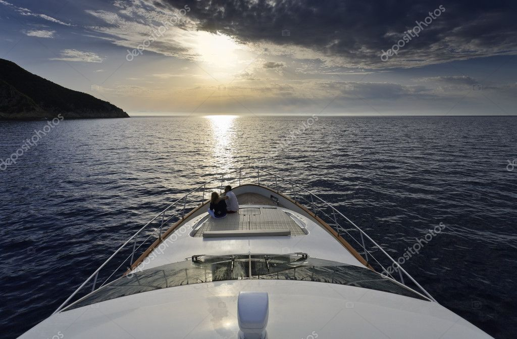 Italy, Elba Island, couple on a luxury yacht at sunset