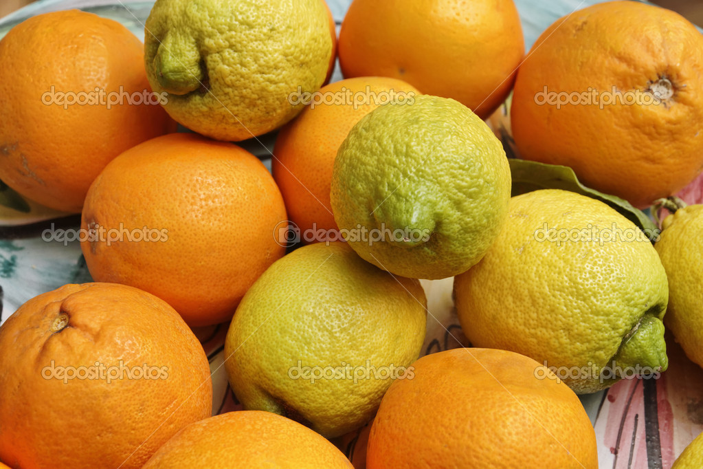 Italy, sicilian oranges and lemons on a decorated dish