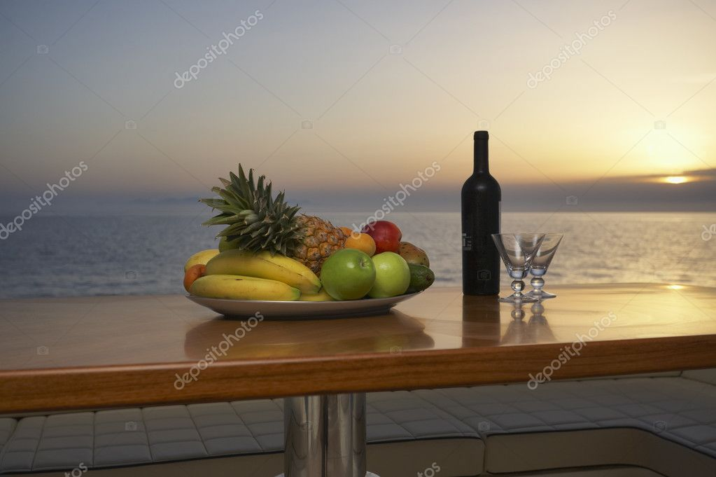 Luxury yacht, poop deck dining table at sunset