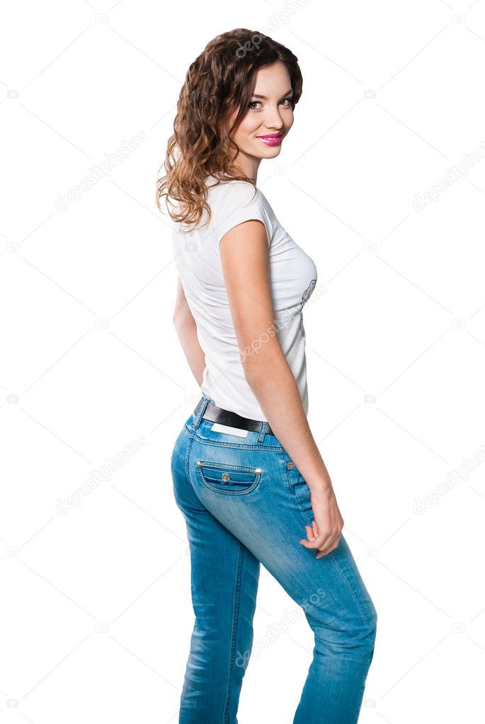 Young woman in white shirt and blue jeans isolated on white ...