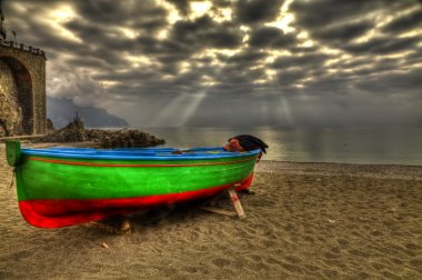 Atrani boat in beach during a strom HDR