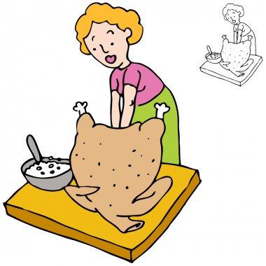 Woman Stuffing Turkey