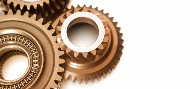Closeup of steel gears meshing together