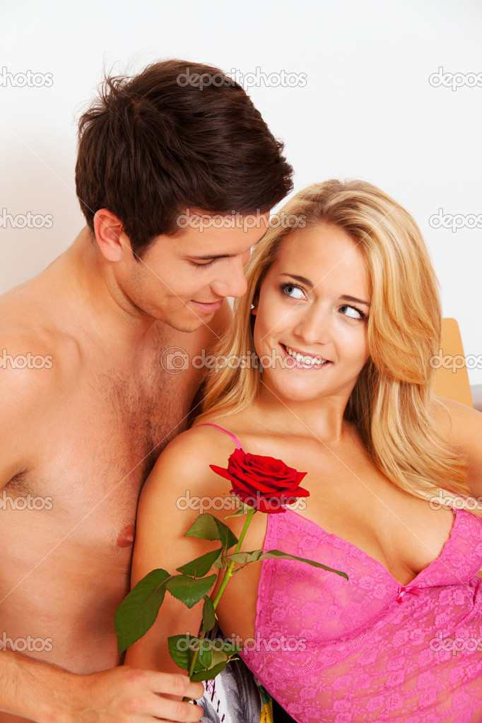 A romantic couple in bed with rose  marry the man    Photo by ginasanders. Romantic couple in bed with rose    Stock Photo   ginasanders
