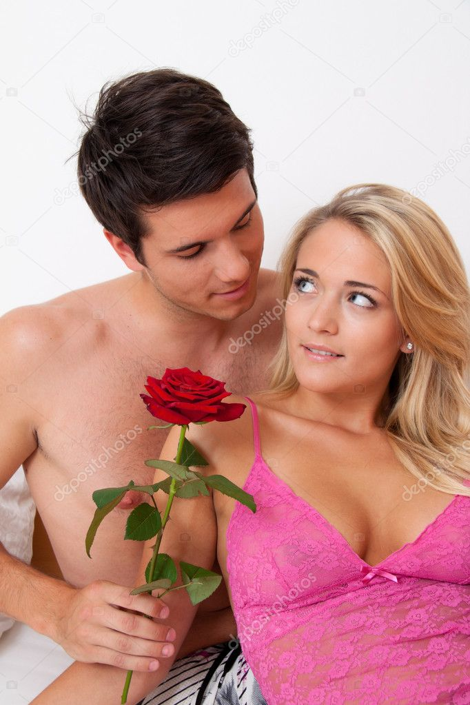 A romantic couple in bed with rose  marry the man    Photo by ginasanders. Romantic couple in bed with rose   Stock Photo   ginasanders  8188707