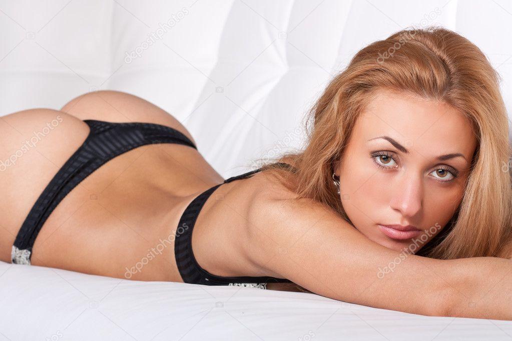 Gorgeous sexy brunette girl in sensual black lingerie
