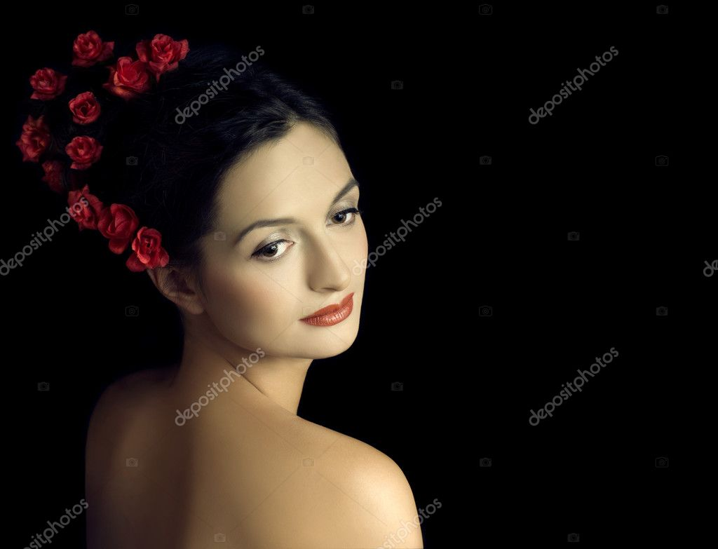Beautiful girl with red flowers in hairs