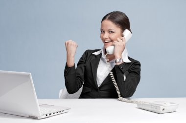 Casual business woman in office talking by phone