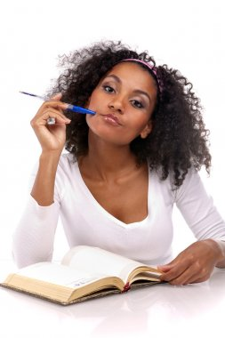 A beautiful dark-skinned woman with a note-book in a white dress