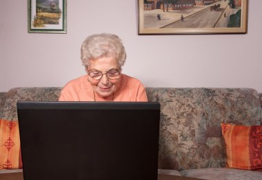 An old woman with a laptop