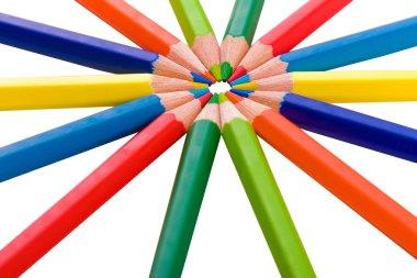 Color pencils in arrange in color wheel colors on white backgrou