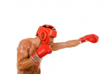 Young Boxer fighter with boxing helmet and gloves making a punch