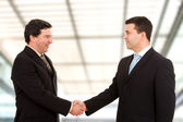 Business shaking hands, finishing up a meeting at modern