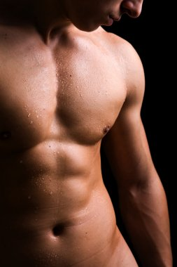 Beauty men torso. Naked body. Isolated on black.