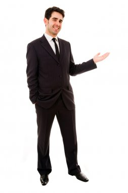 Smiling businessman with arm out in a welcoming gesture , isolat