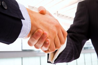 Closeup of business shaking hands over a deal