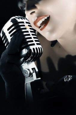 Woman singing in vintage microphone