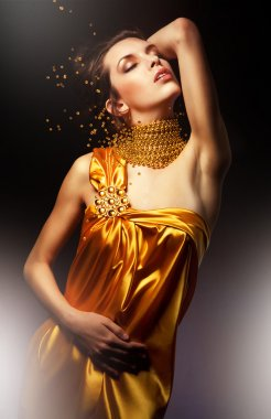 Beautiful woman in long dress with jewelry
