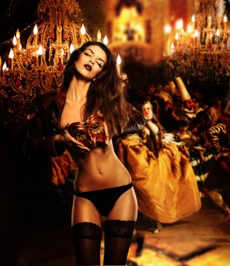Beautiful erotic woman with mask on venetian masquerade ball