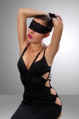 Attractive blindfolded girl posing