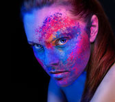 A girl with bright makeup unusual body painting