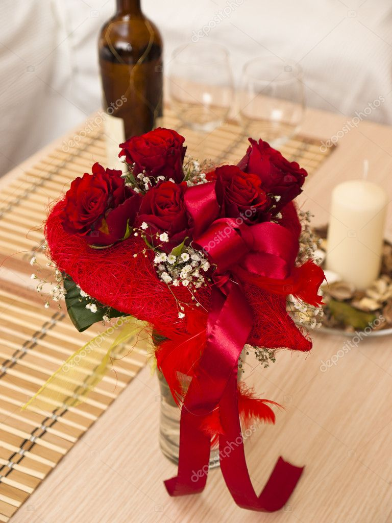 Bouquet of red roses and wine