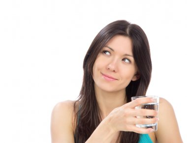 Woman drinking water from clear glass
