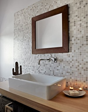 Detail of ceramic washbasin in modern bathroom