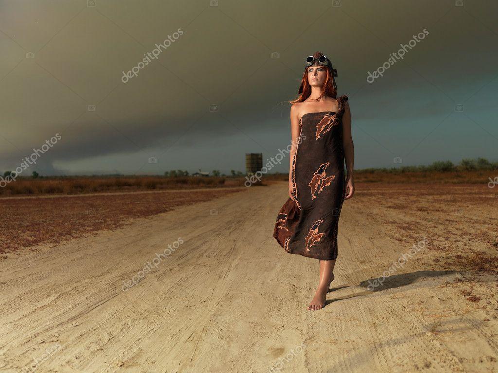 Fashion portrait woman aviator outfit walking alone