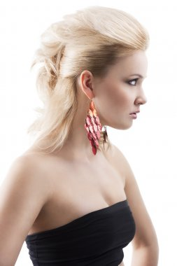 Red earring on cute blond girl, with an axpression of surprise,