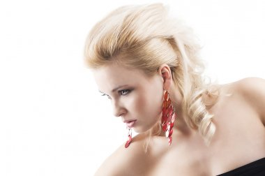 Red earring on cute blond girl, she bent at the right