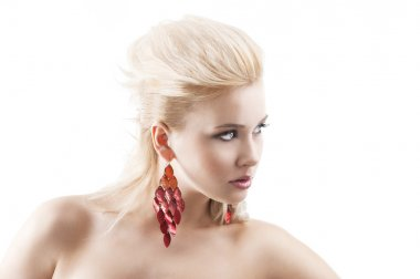 Red earring on cute blond girl, in front of the camera with a he