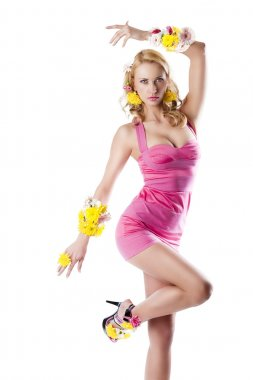 Flower fashion girl with pink dress with left arm on the head