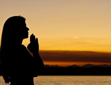 Woman of faith prays outdoors