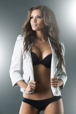 Gorgeous sexy woman in black lingerie and jacket