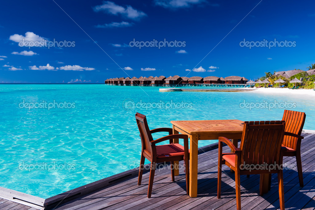 Table and chairs at beach restaurant Stock Photo  : depositphotos9650863 stock photo table and chairs at beach from depositphotos.com size 1023 x 682 jpeg 104kB