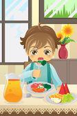 chlapec jíst zeleninu