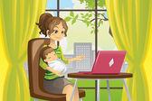 Fényképek Anya és a baba használ laptop
