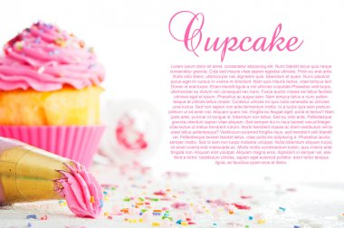 Cupcake and decorating bag on a white table with colorful sugar